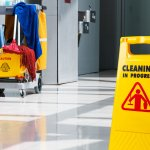 Janitorial mop and bucket with cleaning sign